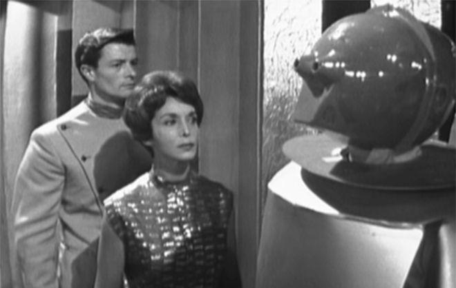 Susan Calvin looks at a robot