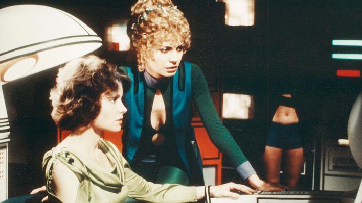 Two women at a futuristic console